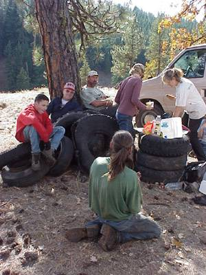 Volunteers resting together after loading the tires.