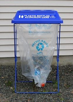 "A blue container labeled, ""Plastic bottles and aluminum cans."""