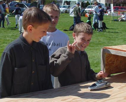 People view exhibits and participate in activities related to alternative energy.