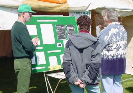 People view a variety of informational booths and exhibits at the Earth Day celebration.