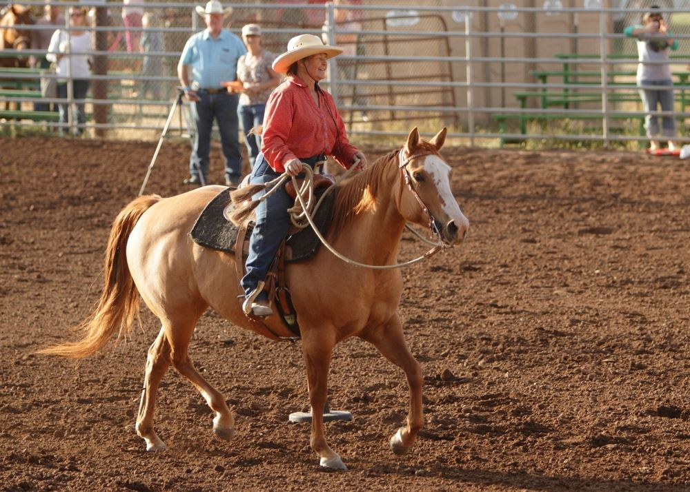 Woman rides her horse in the arena at the 2014 Klickitat County Fair.