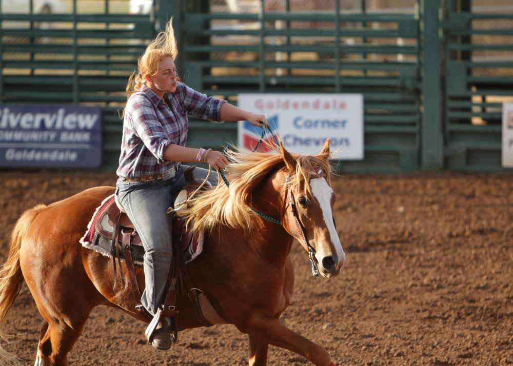 A young woman rides her horse in the arena at the 2014 Klickitat County Fair.