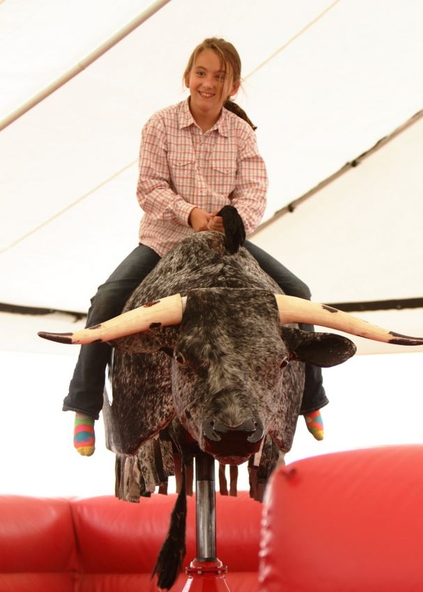 A girl gets ready to attempt a ride on the mechanical bull at the 2014 Klickitat County Fair.