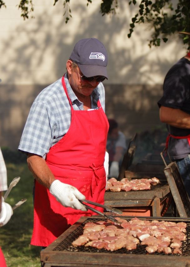 A man cooks food to serve at the 2014 Klickitat County Fair.