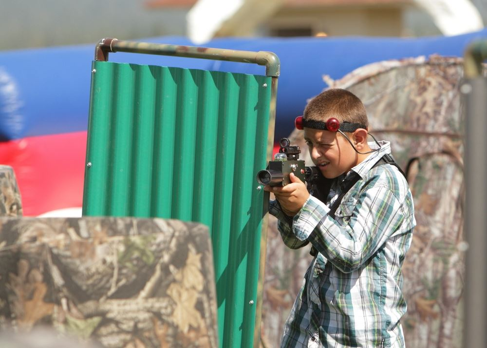 A little boy plays laser tag at the 2014 Klickitat County Fair.