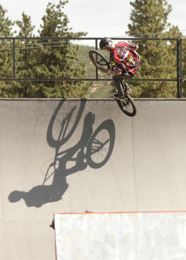 A man does tricks on his BMX bike.