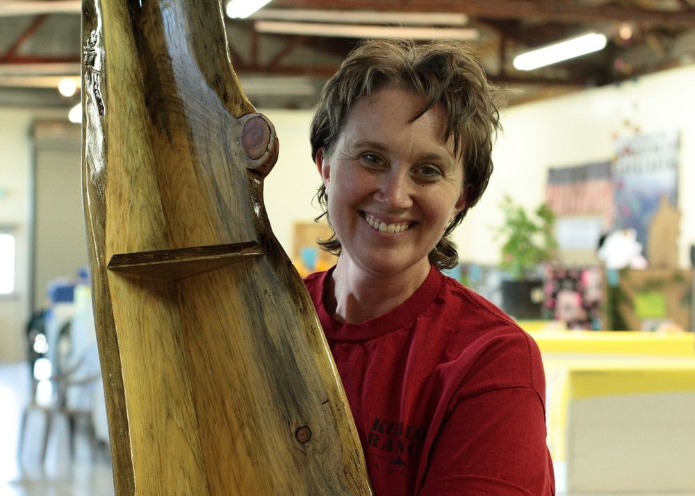 A woman shows a beautiful wooden shelf at the 2014 Klickitat County Fair.