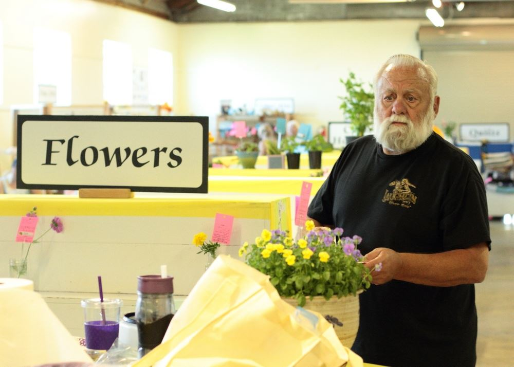 A man shows flowers at a flower exhibit at the 2014 Klickitat County Fair.