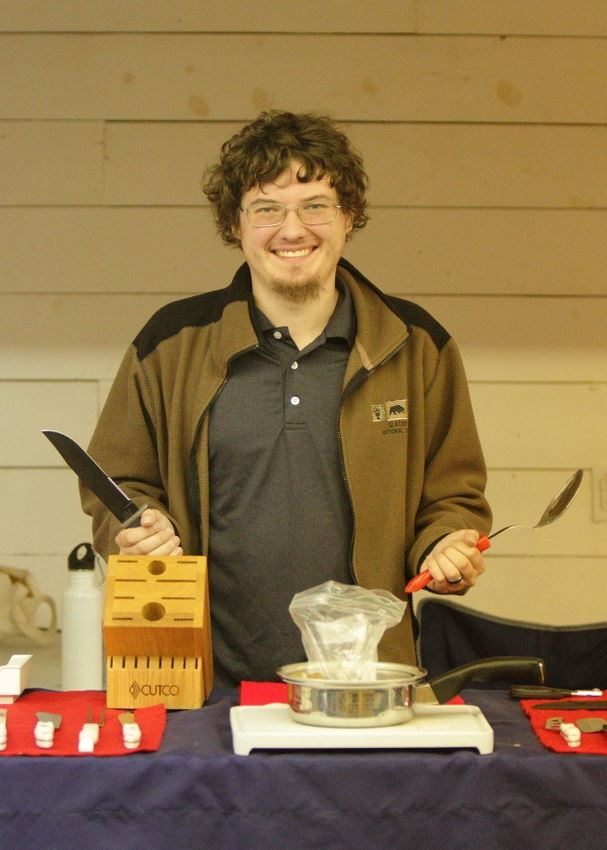 A man shows Cutco products at the 2014 Klickitat County Fair.