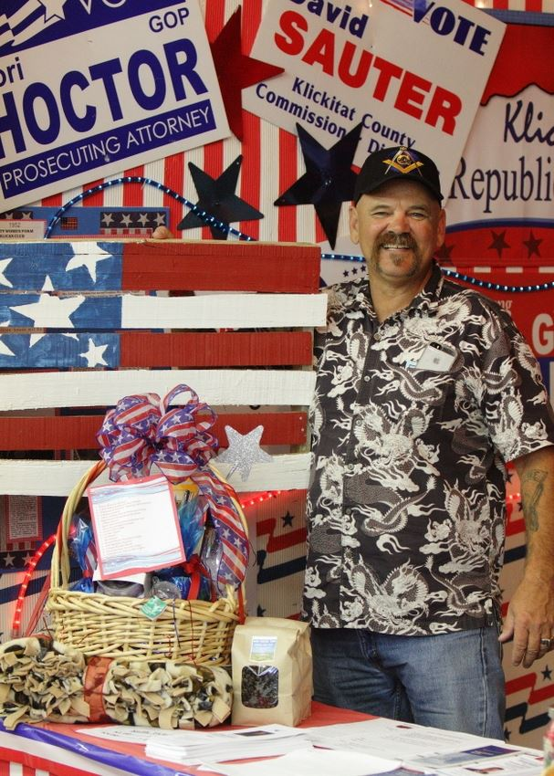 A man stands at a patriotic exhibit at the 2014 Klickitat County Fair.