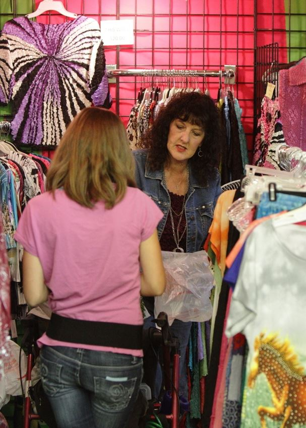 Women stand at a clothing booth at the 2014 Klickitat County Fair.
