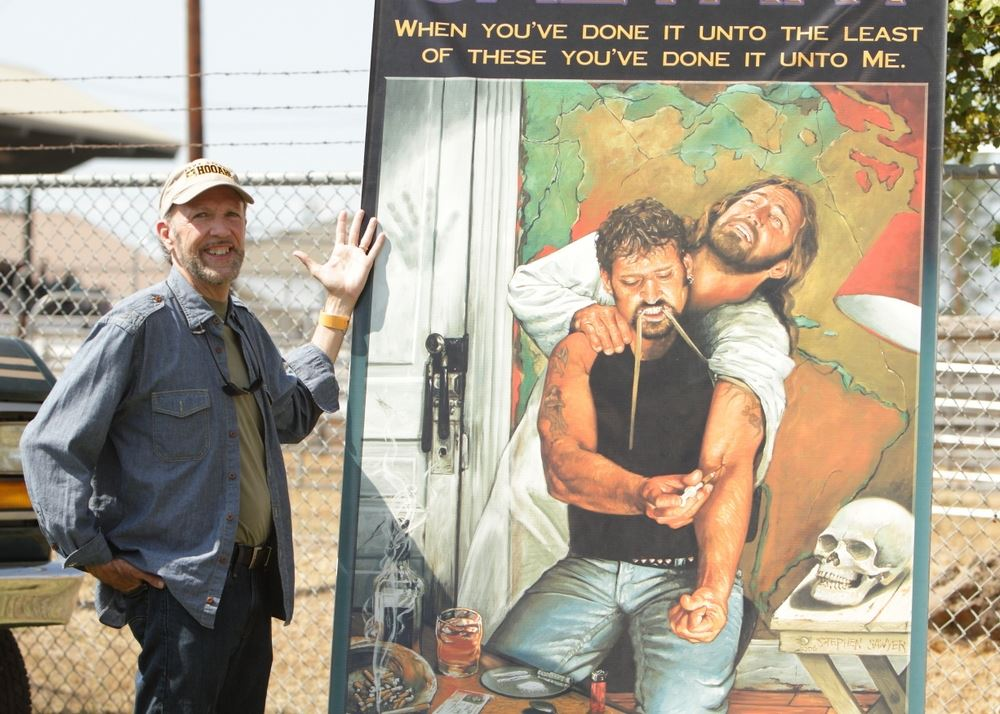 A man stands next to an anti-drug image at the 2014 Klickitat County Fair.