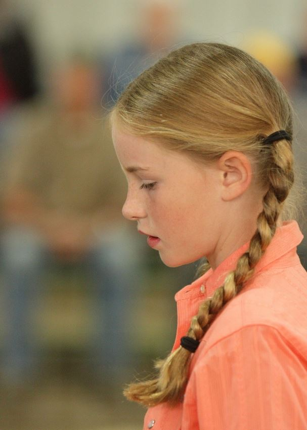A little girl with braided pig tails at the 2014 Klickitat County Fair.