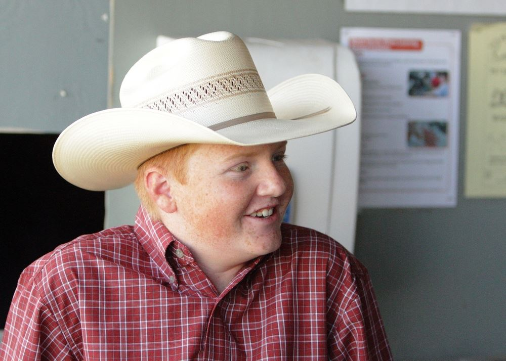 A young man wearing a cowboy hat attends the 2014 Klickitat County Fair.
