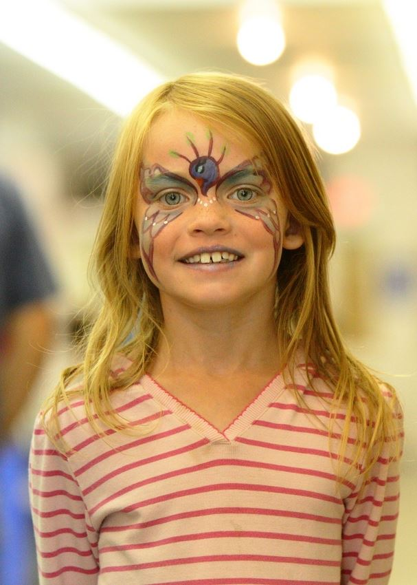 A little girl has her face painted at the 2014 Klickitat County Fair.