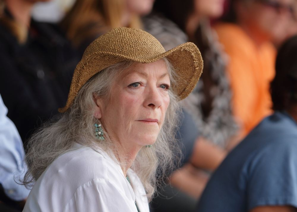A woman sits among the crowd at the 2014 Klickitat County Fair.