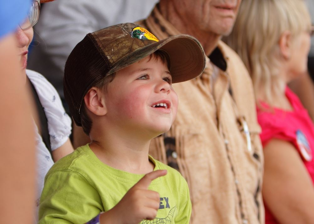 A little boy looks up in amusement at the 2014 Klickitat County Fair.