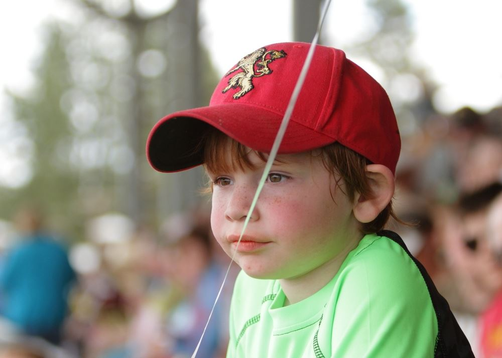 A little boy sits among the crowd at the 2014 Klickitat County Fair.