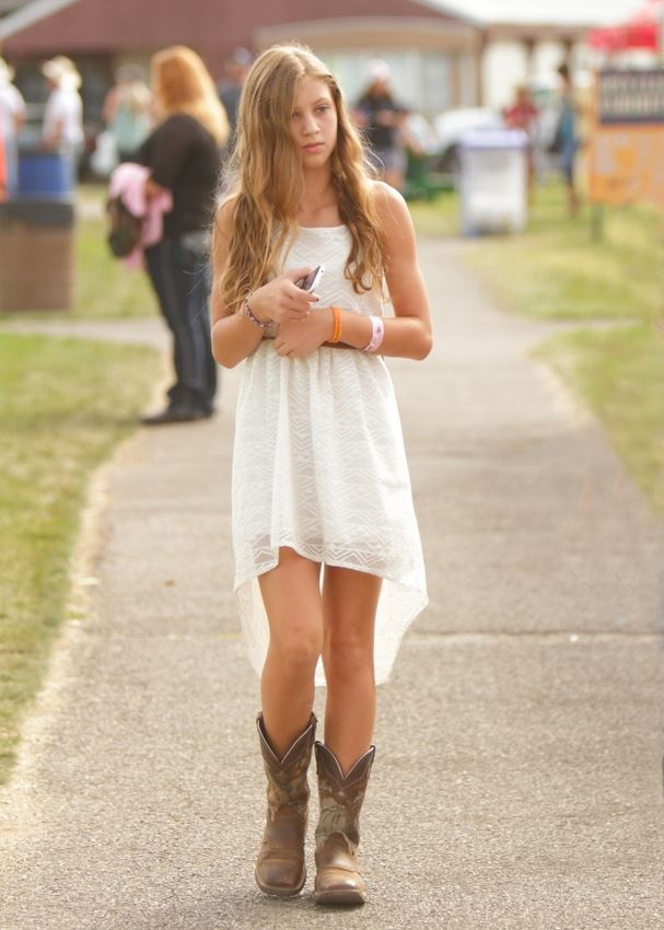 A girl walks along the sidewalk at the 2014 Klickitat County Fair.