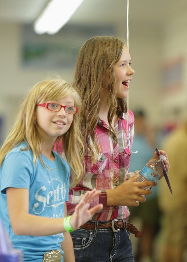 Two girls smile at the 2014 Klickitat County Fair.