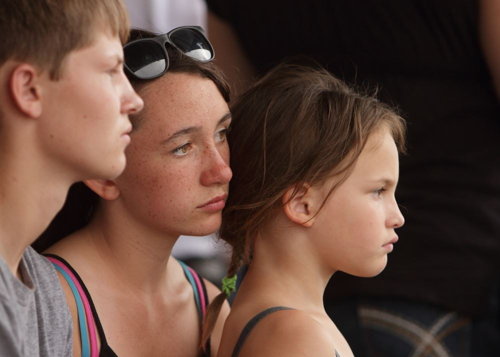 A woman and little girl sit among the crowd at the 2014 Klickitat County Fair.